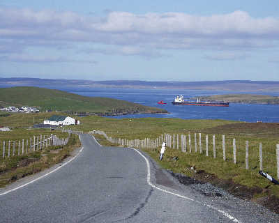 View into Ollaberry - a oil tanker makes it's way to Sullom Voe